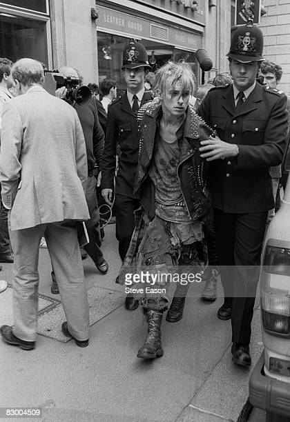 City of London Police officers arrest a young man during a 'Stop The City' anticapitalist demonstration London September 1984