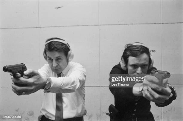 City of London Police officers during firearms training at a shooting range in the basement of Bishopsgate police station, London, 6th April 1973.