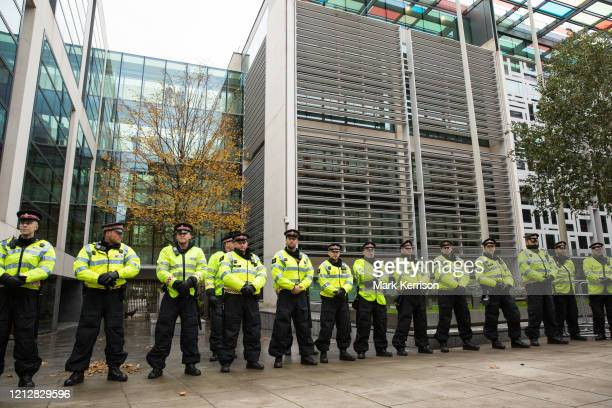 City of London police officers line up in front of the Home Office to observe thousands of students attending a National Demonstration for a Free...