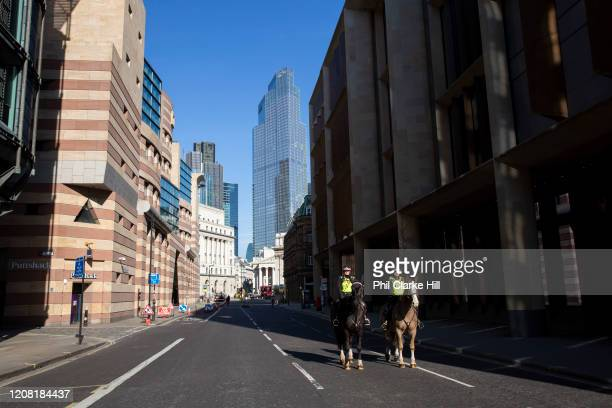 City of London Police on horseback in a deserted street in the City of London March 24th 2020 was the first day of enforced lockdown in the UK in...