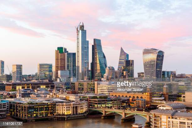 city of london skyline and thames river at sunset, high angle view, london, uk - skyline stock pictures, royalty-free photos & images