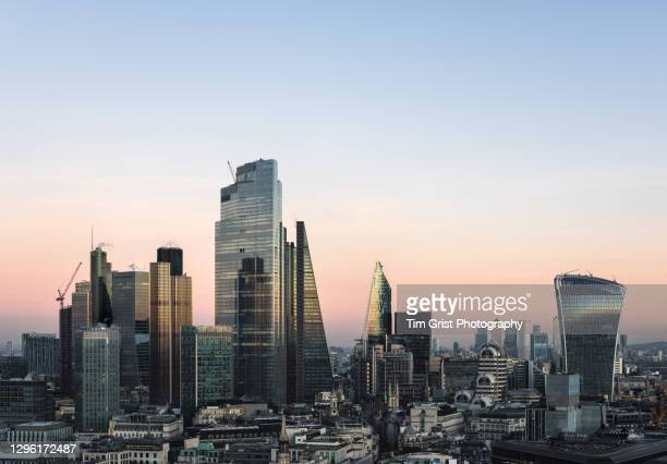 city of london skyline at sunset - finance and economy stock pictures, royalty-free photos & images