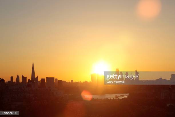 city of london skyline at sunset - suns stock photos and pictures