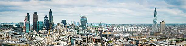 city of london skyscrapers and the shard highrise cityscape panorama - canary wharf stock photos and pictures