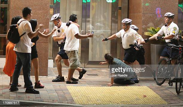 City of Miami Police attempt to clear a street of Miami Heat revellers celebrating their NBA title victory against the San Antonio Spurs on June 20...