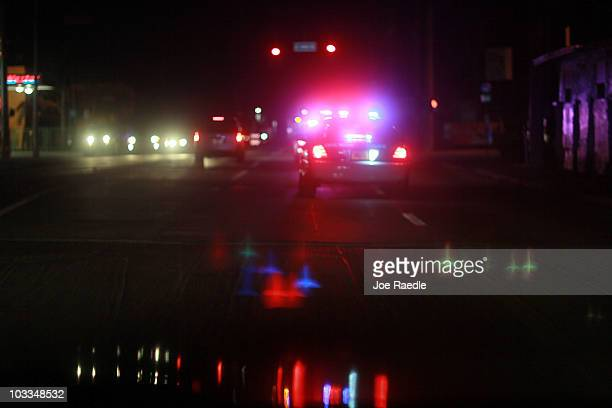 City of Miami police car with lights ablaze responds to a call as they patrol the street on August 11 2010 in Miami Florida The Miami Police...