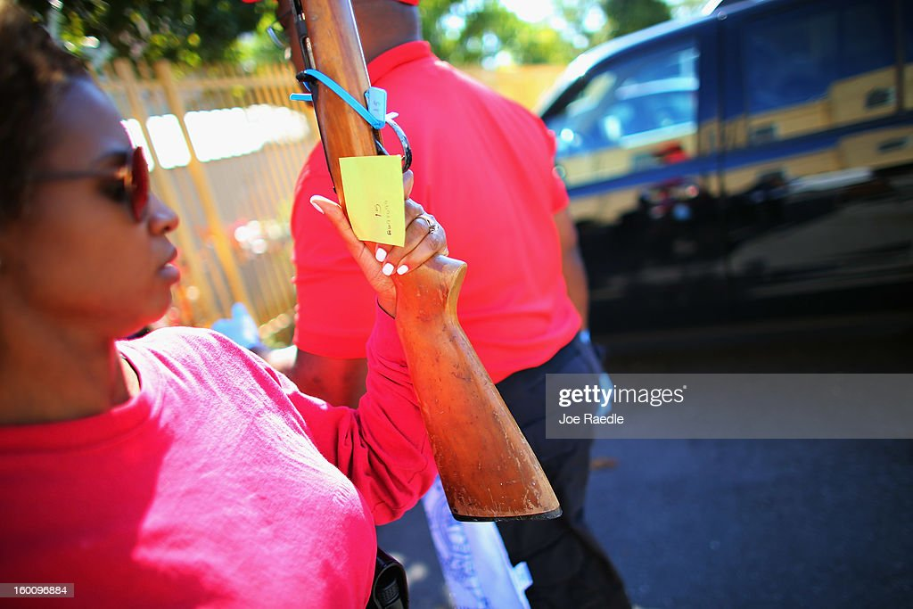 City of Miami police officers Latrice Payen processes a weapon turned in during a gun buy back event on January 26, 2013 in Miami, Florida. The event was the second one of the year in efforts to reduce gun violence, the first one brought in 130 guns.