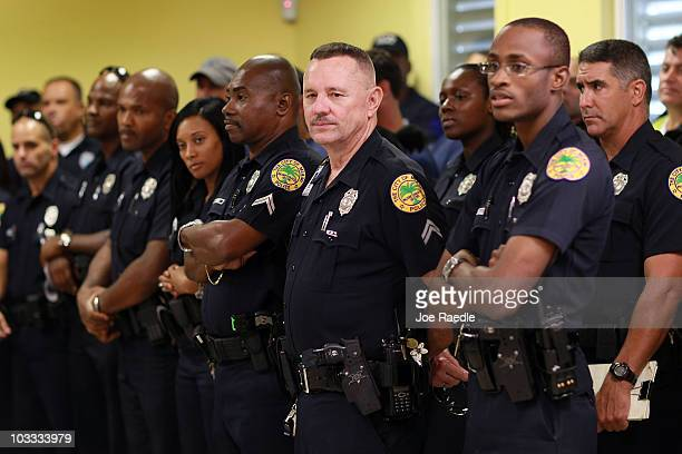 city of miami police officers lineup for roll call as they prepare to head out on