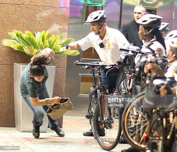 City of Miami Police push a woman to the ground as they try to clear a street of Miami Heat revellers after the Heat won the NBA title against the...