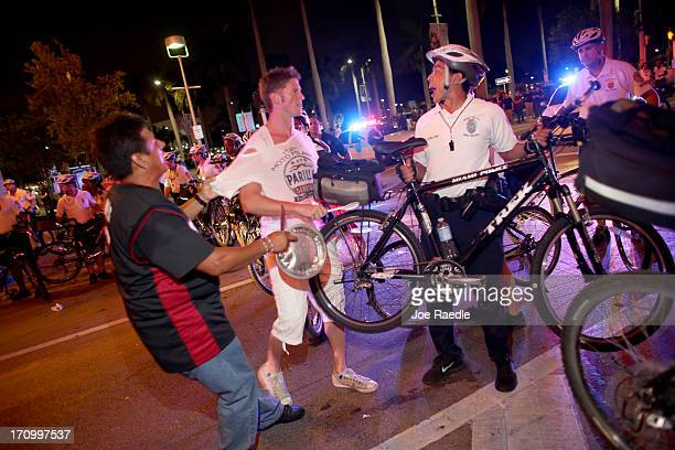City of Miami Police try to clear a street of Miami Heat revellers after the Heat won the NBA title against the San Antonio Spurs June 20 2013 in...