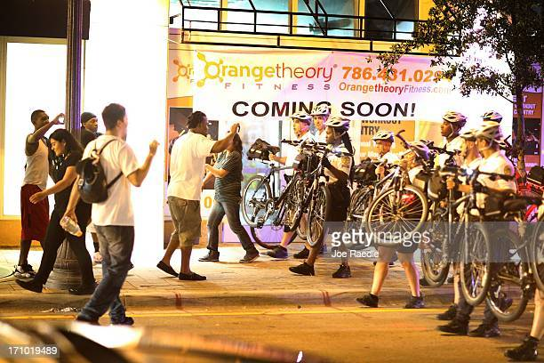 City of Miami Police try to clear a street of Miami Heat revellers after the Heat won the NBA title against the San Antonio Spurs on June 20 2013 in...