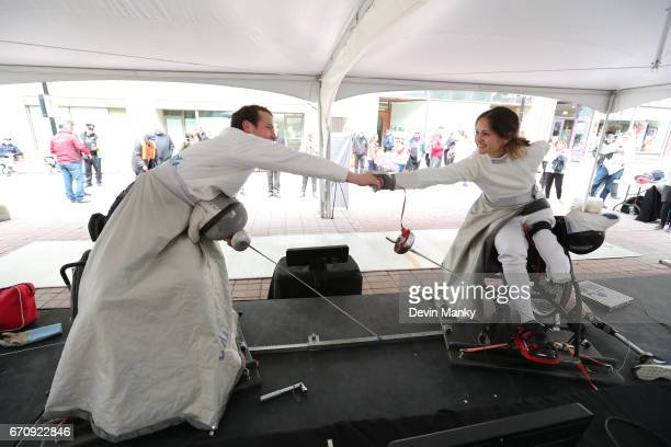 City of Ottawa Councillor Mathieu Fleury and Paralympian Camille Chai shake hands after demonstrating wheelchair fencing during an outdoor...