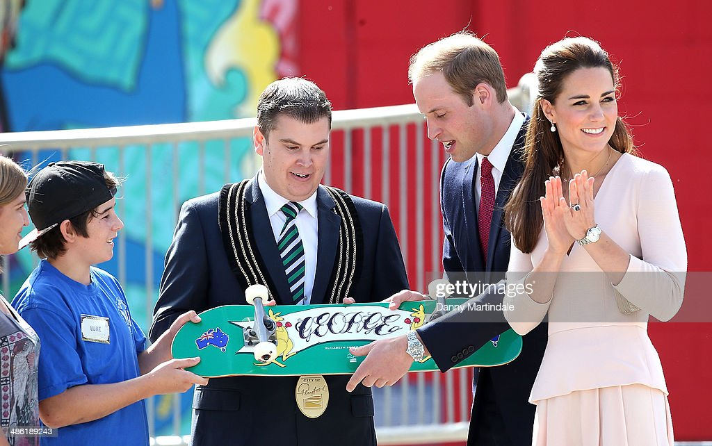 City of Playford Mayor, Mr Glenn Docherty, presents a skateboard with 'George' to Prince William, Duke of Cambridge and Catherine, Duchess of Cambridge at a skate park in Elizabeth, on April 23, 2014 in Adelaide, Australia. The Duke and Duchess of Cambridge are on a three-week tour of Australia and New Zealand, the first official trip overseas with their son, Prince George of Cambridge.