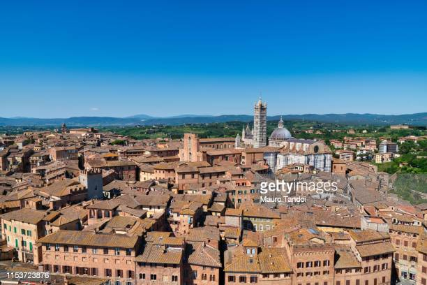 city of siena and its cathedral (duomo) of santa maria assunta, tuscany - mauro tandoi stock photos and pictures