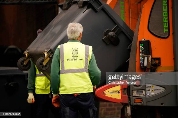 City of StokeonTrent refuse collectors empty bins in the city centre on May 29 2019 in StokeonTrent England The StokeonTrent city council experienced...