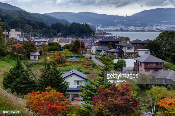 city of suwa on the lake suwako, japan - 諏訪市 ストックフォトと画像