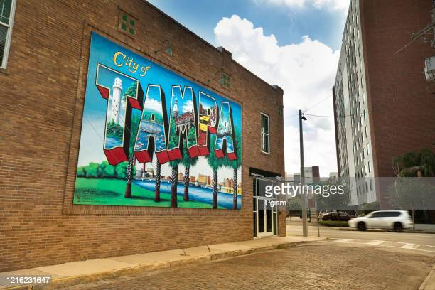 city of tampa florida postcard welcome sign on a downtown wall - tampa stock pictures, royalty-free photos & images