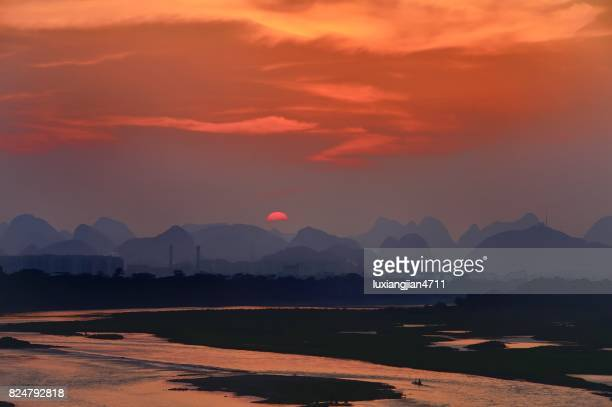 City of the famous karst in sunset clouds