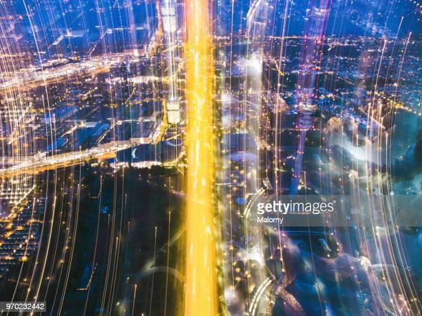 city of the future at night. top view, view from above, aerial view - olympischer park veranstaltungsort stock-fotos und bilder