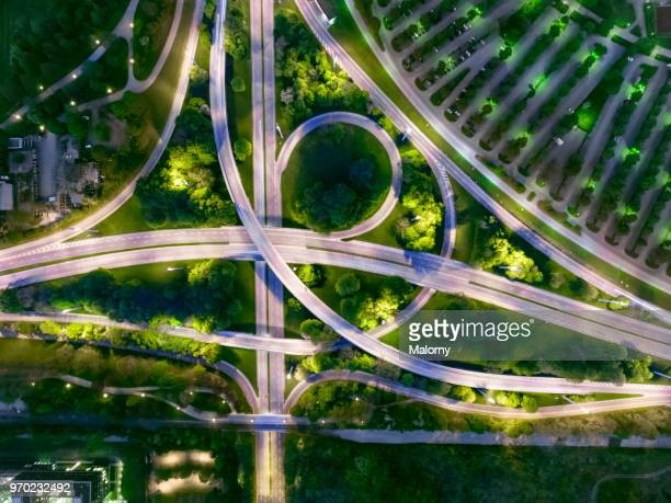 city of the future at night. top view, view from above, aerial view - verkehrswesen stock-fotos und bilder