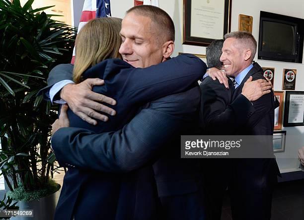 City of West Hollywood mayor pro tempore John D'Amico hugs Heidi Shink of the Stonewall Democratic Club as John O'Connor of Equality California hugs...