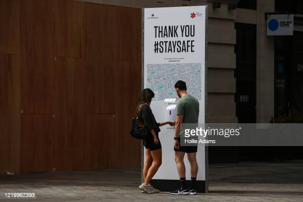 """City of Westminster hand sanitiser station on Oxford Street on June 14, 2020 in London, England. Many """"non-essential"""" shops are allowed to reopen..."""