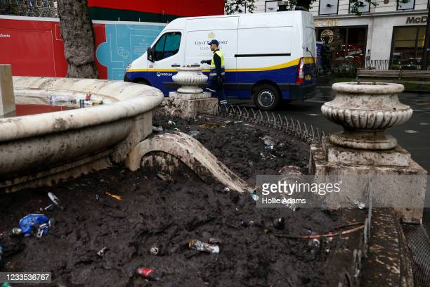 City of Westminster worker cleaning up after football fans in Leicester Square on June 19, 2021 in London, England. England and Scotland drew 0-0 in...