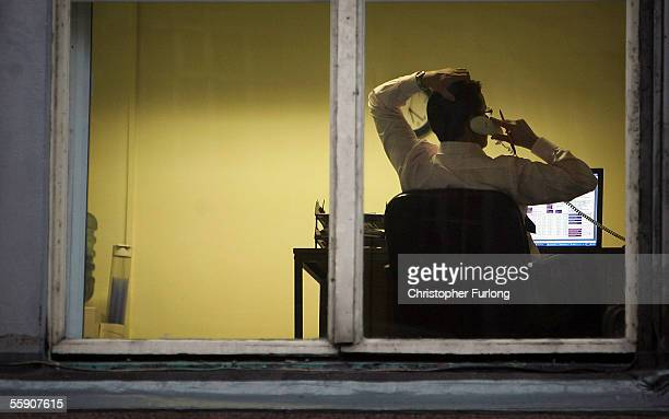 A city office employee works into the night as darkness closes in on October 10 2005 in Glasgow Scotland Seasonal affective disorder or winter...