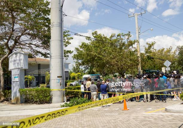 City officials and medical staff address the media outside of a rehabilitation center in the city where six patients were found dead September 13...