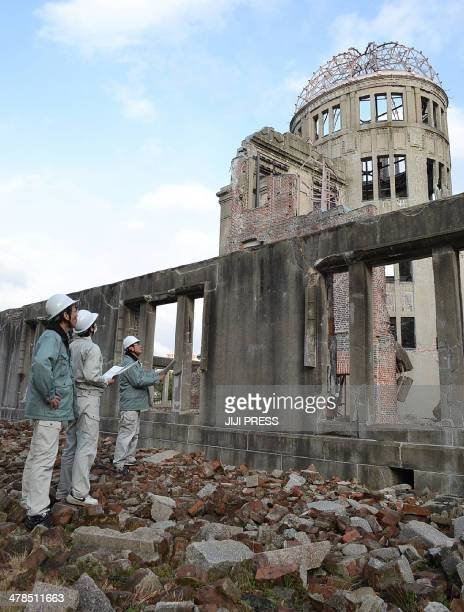 City officials of Hiroshima inspect the Atomic Bomb Dome in Hiroshima western Japan on March 14 2014 after a strong 63magnitude earthquake struck off...