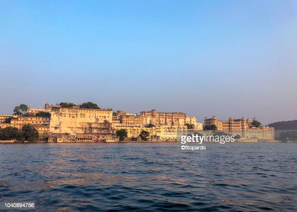 city palace and a beautiful sunset at udaipur - monument stock pictures, royalty-free photos & images
