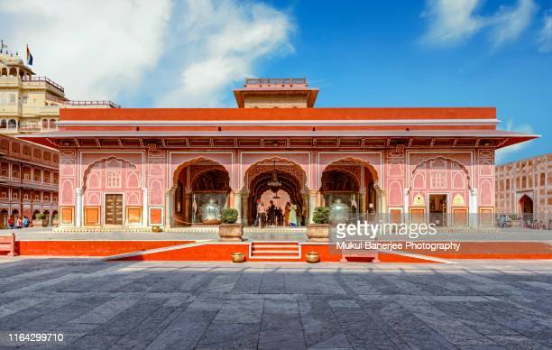 city palace, jaipur, which includes the chandra mahal and mubarak mahal palaces and other buildings, is a palace complex in jaipur, the capital of the rajasthan state, india. - palace stock pictures, royalty-free photos & images