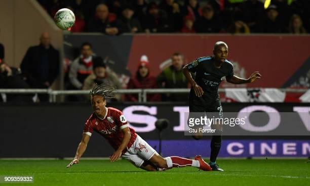 City player Fernandinho challenges Bobby Reid of Bristol City during the Carabao Cup SemiFinal Second Leg match between Bristol City and Manchester...
