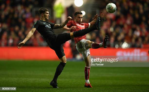 City player John Stones is challenged by Joe Bryan of Bristol City during the Carabao Cup SemiFinal Second Leg match between Bristol City and...