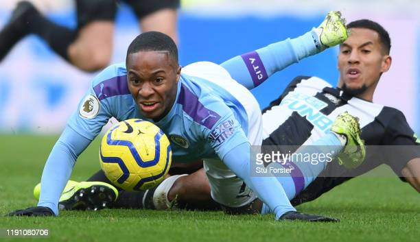 City player Raheem Sterling is challenged by Isaac Hayden during the Premier League match between Newcastle United and Manchester City at St. James...