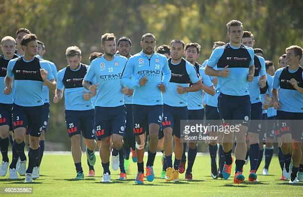 City players run during a Melbourne City FC ALeague training session at La Trobe University Sports Fields on December 16 2014 in Melbourne Australia
