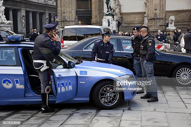City police officers or polizia meet and talk in Piazza della Signoria in Florence Italy Polizia in Italy are municipal police responsible to the...