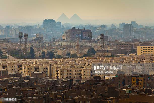 city & pyramids of giza from the citadel. - pyramid shapes around the house stock pictures, royalty-free photos & images