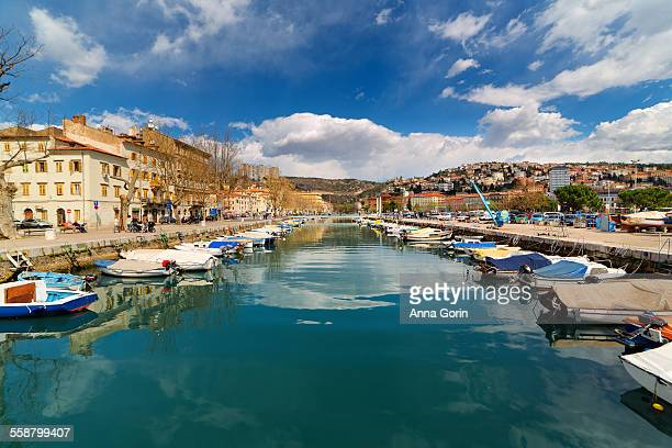 city reflections in canal, rijeka, croatia - rijeka stock pictures, royalty-free photos & images
