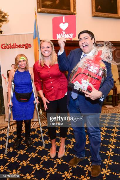 City Representative Sheila Hess and Colleen Labik Public Relations Coordinator for WAWA present Producer Adam F Goldberg with gift basket during an...