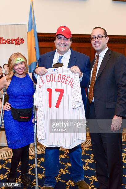 City Representative Sheila Hess and Mike Harris VP Marketing New Media present Producer Adam F Goldberg with customized official Philadelphia...