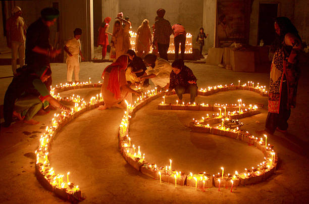 City residents lighting candles on the occasion of Diwali Festival at a Gurudwara at Dugri area on October 30 2016 in Ludhiana India Diwali is one of.