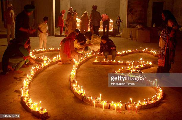 City residents lighting candles on the occasion of Diwali Festival at a Gurudwara at Dugri area on October 30 2016 in Ludhiana India Diwali is one of...