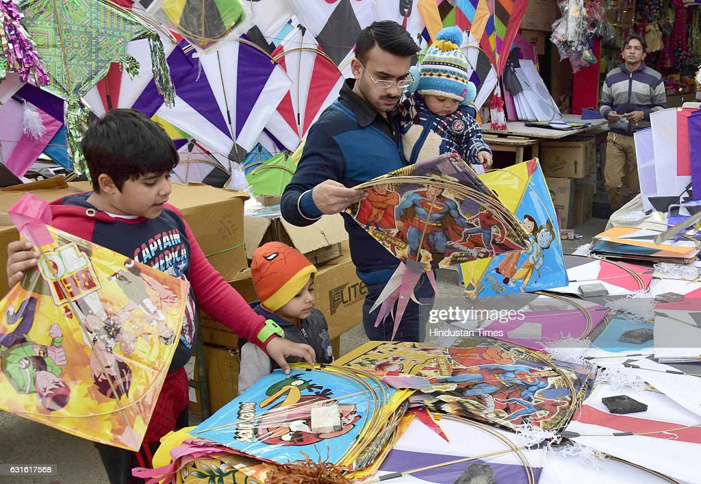 City residents select kites on the Lohri festival from one of the shop on January 13 2017 in Amritsar India