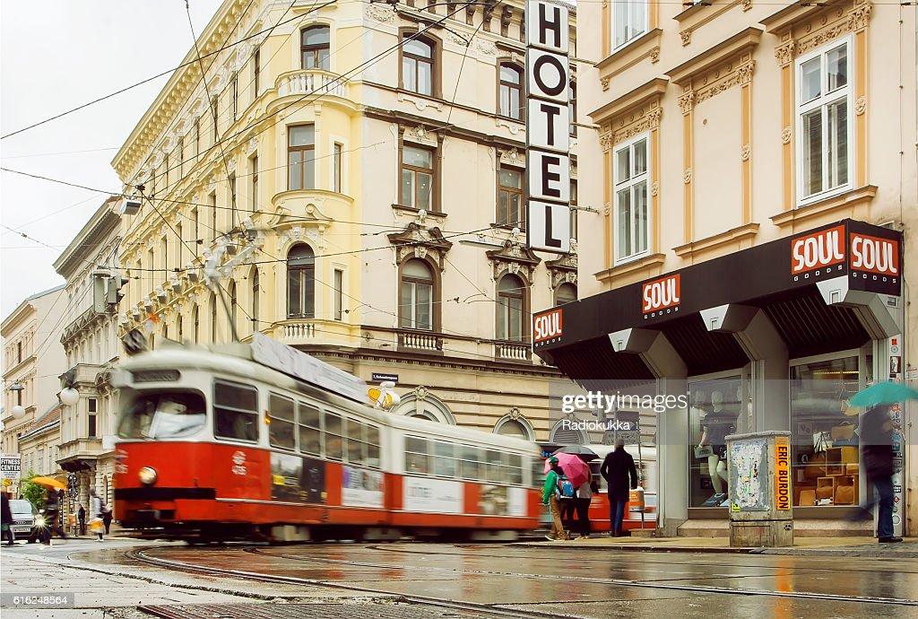 City road after rain and rushing tram : Foto de stock