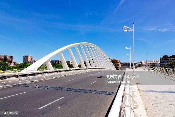 city road and bridge in valencia, spain - valencia fotografías e imágenes de stock