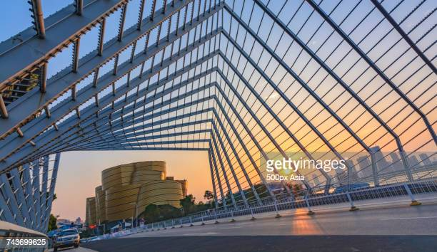 city road at sunset, wuhan, hubei, china - wuhan stock photos and pictures