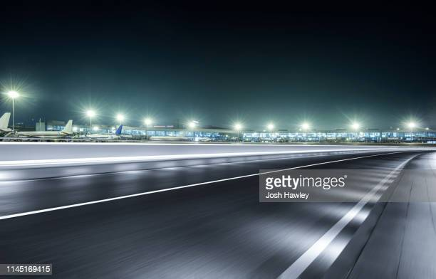 city road - airport tarmac stock pictures, royalty-free photos & images