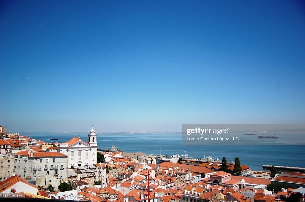 City roofs by river in Lisbon : Stock Photo