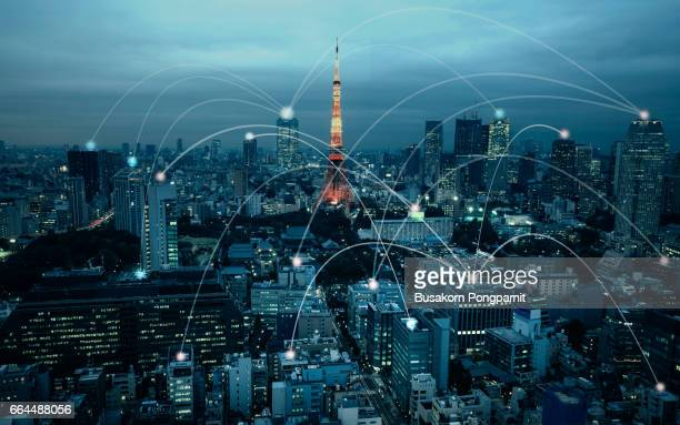 city scape and network connection concept, illuminated by light of cities, surrounded by a luminous network, japan city network technology - atomic imagery stock pictures, royalty-free photos & images